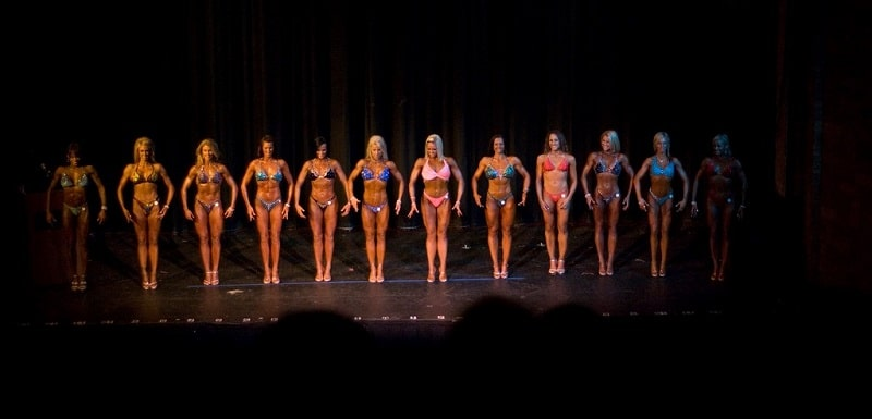 Contestants in a female bodybuilding competition