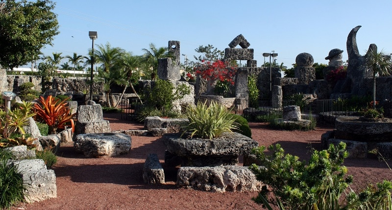 The sun shines on Coral Castle Homestead's stone garden