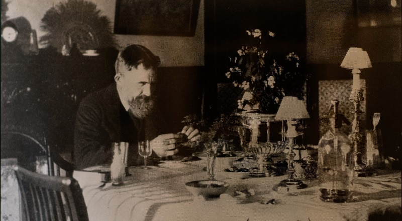 George Bernard Shaw sitting at a dining table