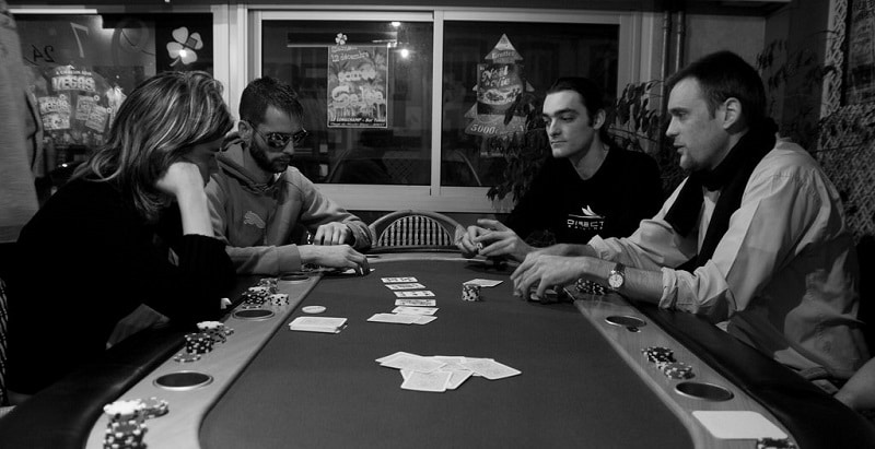 People playing poker around a card table