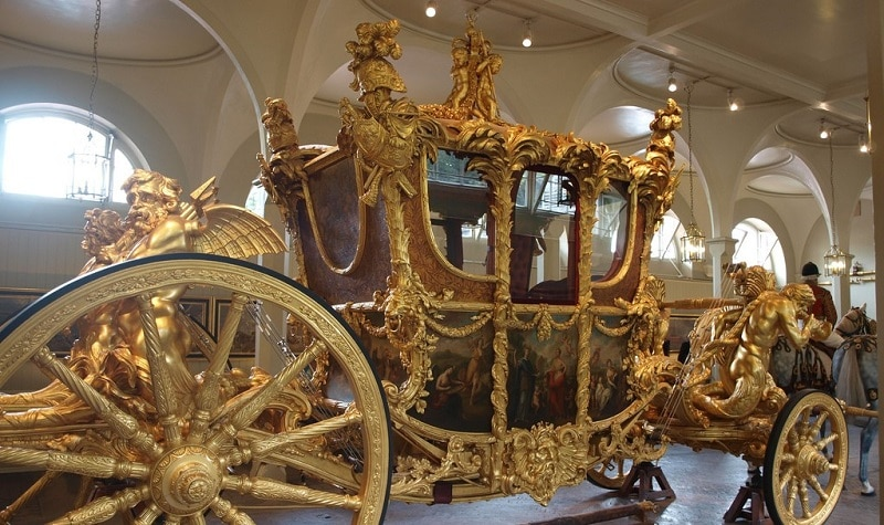 A gold State Coach in The Royal Mews