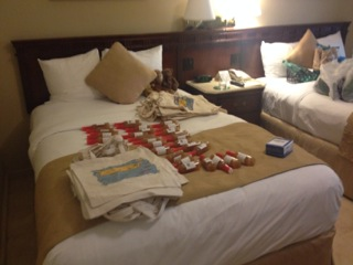 Bianca's welcome bags getting stuffed on the hotel room beds