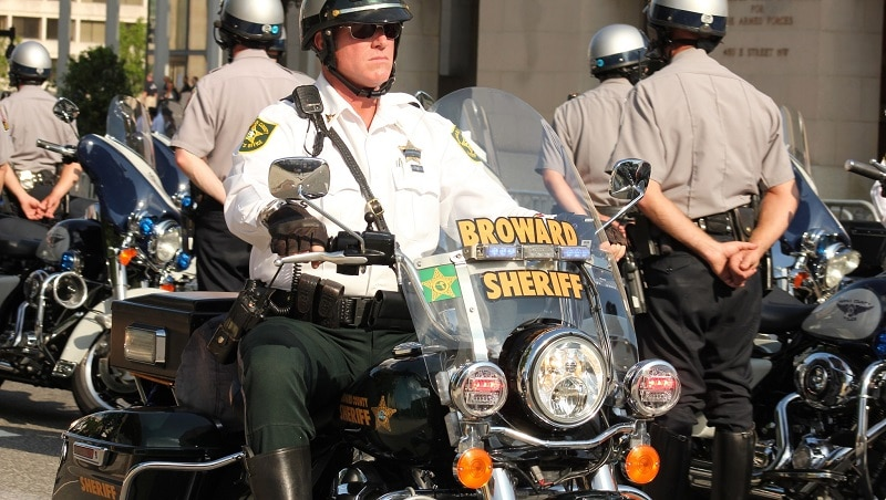 A law enforcement officer from Broward County on his motorcycle