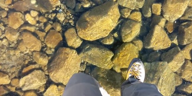 Walking on clear ice across a lake