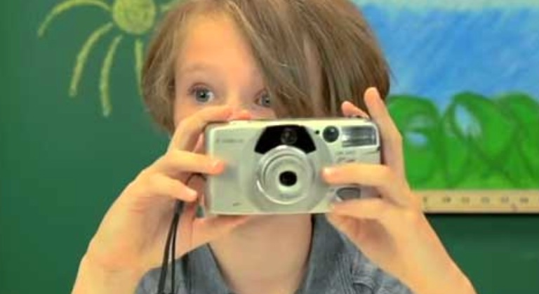Kids check out some older cameras.