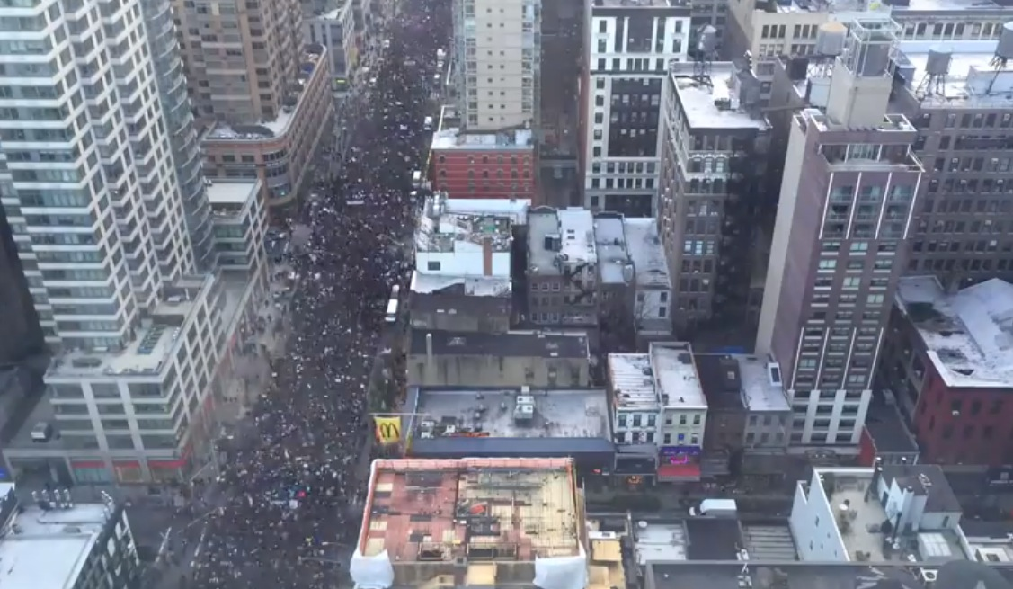 Thousands march through New York City.