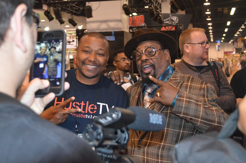 George Clinton with media correspondent from Hustle Tv - Photo credit Kieran MacIntyre for ©M&C