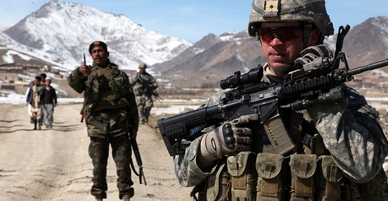 A U.S. Army soldier conducts a patrol with a platoon of Afghan national army soldiers