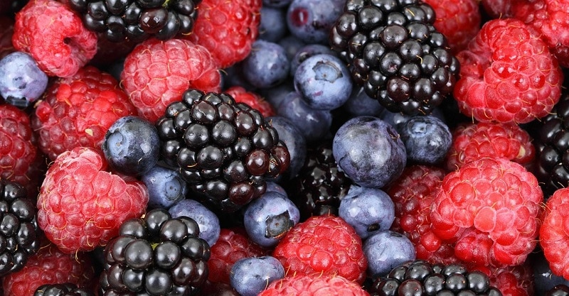 Close-up of raspberries, blackberries and blueberries mixed together