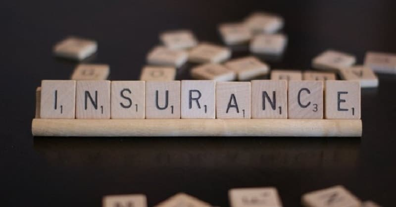 "The word ""insurance"" spelled out using Scrabble letters"