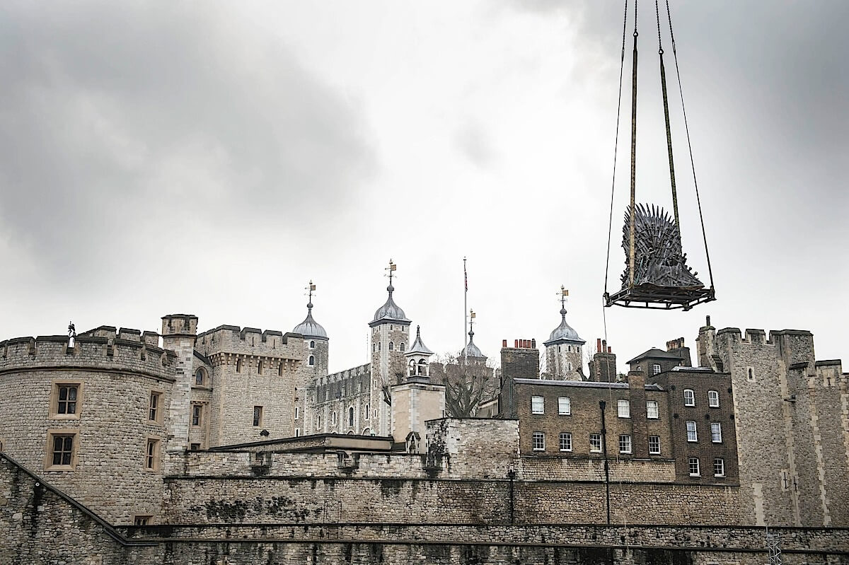 The Game Of Thromnes Throne beng craned into the moat at the Tower of London.