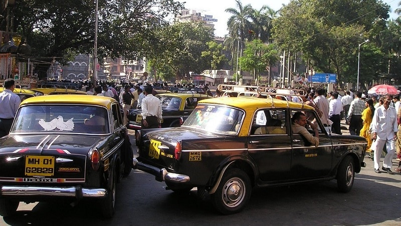 Taxis and pedestrians in Mumbai