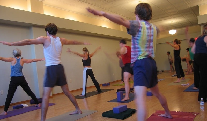 A yoga class taking place in a gym