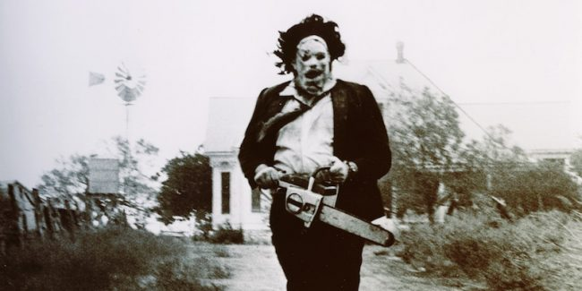Leatherface running towards the camera in The Texas Chainsaw Massacre