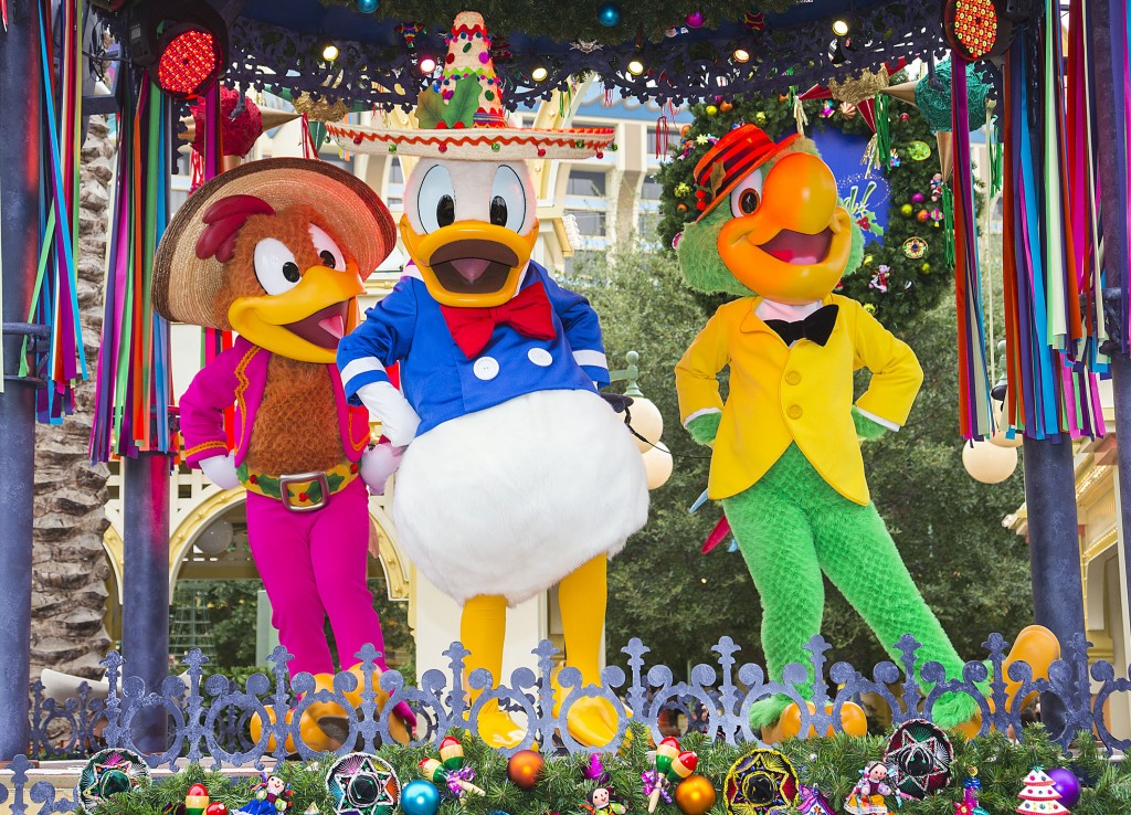 "'DISNEY ¡VIVA NAVIDAD!' (ANAHEIM, Calif.) – Donald Duck, Jose Carioca and Panchito, of The Three Caballeros, join the party at ""¡Disney Viva Navidad!"" at Disney California Adventure park, a celebration of Latino culture and seasonal traditions, all part of Holidays at the Disneyland Resort. Returning Nov. 13 through Jan. 6, 2016, there's no better time to create magical memories with loved ones at the Disneyland Resort. Disneyland park transforms into a dazzling winter wonderland with beautiful décor, snowfall on Main Street, U.S.A. and the return of ""it's a small world"" Holiday and Haunted Mansion Holiday. This year, the Diamond Celebration adds even more sparkle to the festive entertainment with A Christmas Fantasy parade, ""Disney ¡Viva Navidad!,"" ""Paint the Night"" and the ""Disneyland Forever"" fireworks spectacular. (Paul Hiffmeyer/Disneyland Resort)"