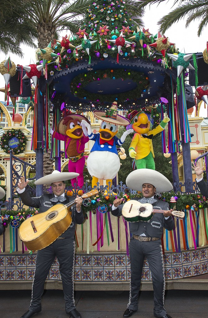 """DISNEY ¡VIVA NAVIDAD!"" (ANAHEIM, Calif.) – Donald Duck, Jose Carioca and Panchito, of The Three Caballeros, join the party at ""¡Disney Viva Navidad!"" at Disney California Adventure park, a celebration of Latino culture and seasonal traditions, all part of Holidays at the Disneyland Resort. The Holidays are a magical time to create unforgettable memories with loved ones at the Disneyland Resort. This merry season runs Nov. 13 through Jan. 6, 2016, as Disneyland park becomes a dazzling winter wonderland with festive décor, holiday-themed treats and attractions transformed for the season – ""it's a small world"" Holiday and Haunted Mansion Holiday. This year, the Diamond Celebration adds even more sparkle to the exciting entertainment, which includes ""A Christmas Fantasy"" parade, ""Disney ¡Viva Navidad!,"" ""Paint the Night"" nighttime parade and the ""Disneyland Forever"" fireworks spectacular. (Paul Hiffmeyer/Disneyland Resort)"
