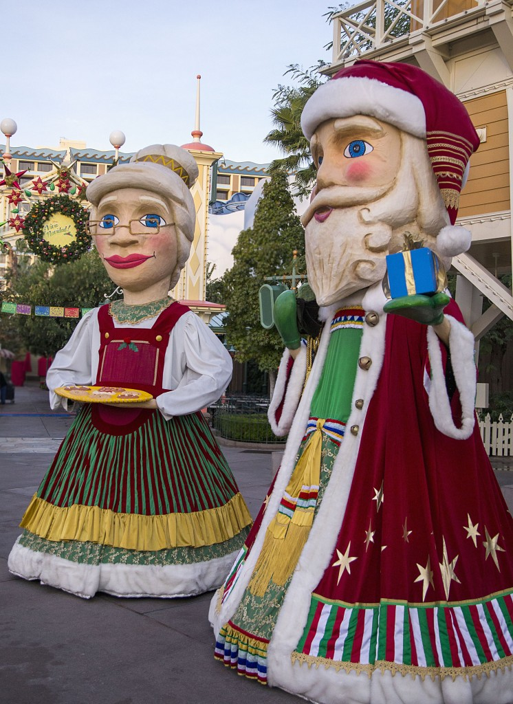 "'DISNEY ¡VIVA NAVIDAD!' (ANAHEIM, Calif.) –Mojiganga puppets of Santa and Sra. Claus make their way through Paradise Garden at ""¡Disney Viva Navidad!"" at Disney California Adventure park, a celebration of Latino culture and seasonal traditions, all part of Holidays at the Disneyland Resort. Returning Nov. 13 through Jan. 6, 2016, there's no better time to create magical memories with loved ones at the Disneyland Resort. Disneyland park transforms into a dazzling winter wonderland with beautiful décor, snowfall on Main Street, U.S.A. and the return of ""it's a small world"" Holiday and Haunted Mansion Holiday. This year, the Diamond Celebration adds even more sparkle to the festive entertainment with A Christmas Fantasy parade, ""Disney ¡Viva Navidad!,"" ""Paint the Night"" and the ""Disneyland Forever"" fireworks spectacular. (Paul Hiffmeyer/Disneyland Resort)"