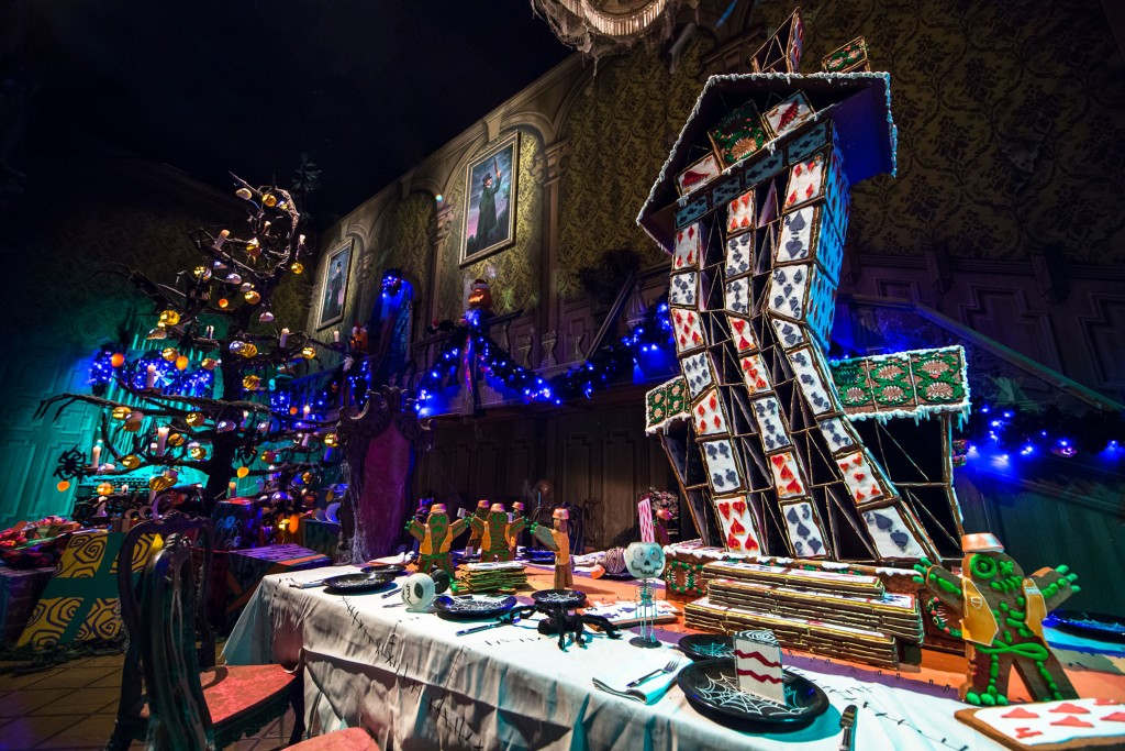 "GINGERBREAD HOUSE OF CARDS (ANAHEIM, Calif.) – An annual treat for the Halloween and Holiday seasons at the Disneyland Resort is each year's new gingerbread house at Haunted Mansion Holiday, a festive attraction guests can experience now through Jan. 6, 2016. A team of Disney bakers, engineers and designers develop the house for the ballroom scene of the Mansion, and this year's design features clumsy gingerbread men constructing a teetering ""House of Cards."" (Disneyland Resort)"