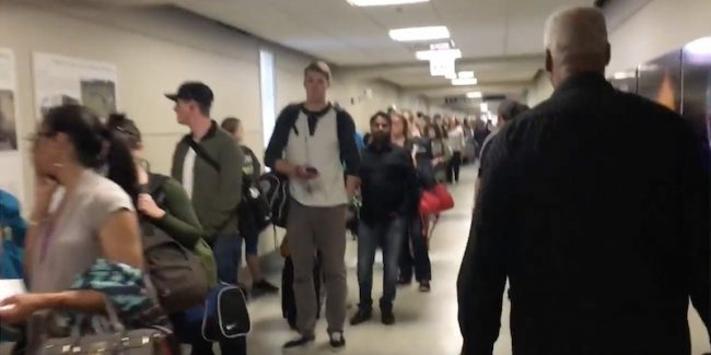 This airport security queue at Chicago Midway will put you off flying forever