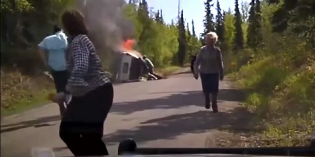 Dash cam captures dramatic rescue of man from burning SUV