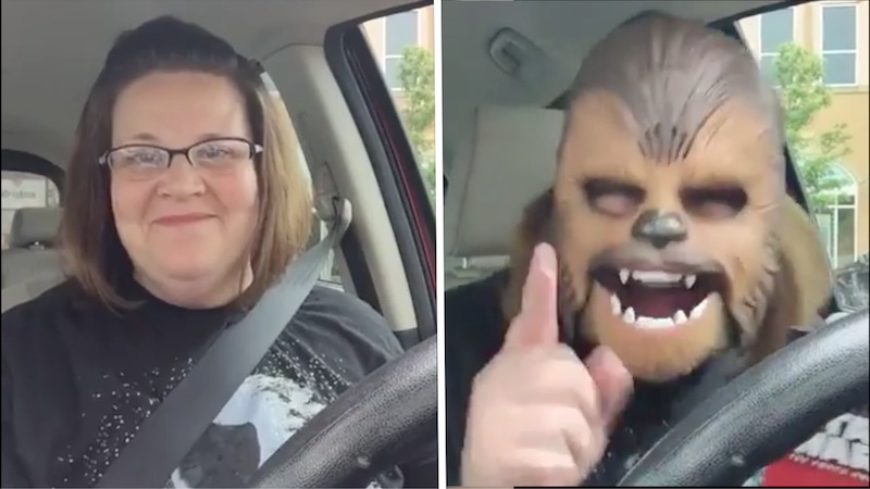 woman-trying-on-chewbacca-mask