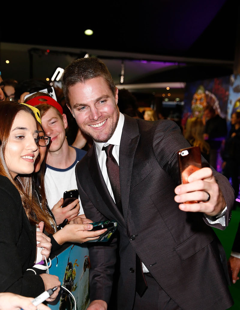 SYDNEY, AUSTRALIA - MAY 29: Stephen Amell poses with fans ahead of the Australian premiere of Teenage Mutant Ninja Turtles 2 at Event Cinemas George Street on May 29, 2016 in Sydney, Australia. (Photo by Brendon Thorne/Getty Images for Paramount Pictures) *** Local Caption *** Stephen Amell