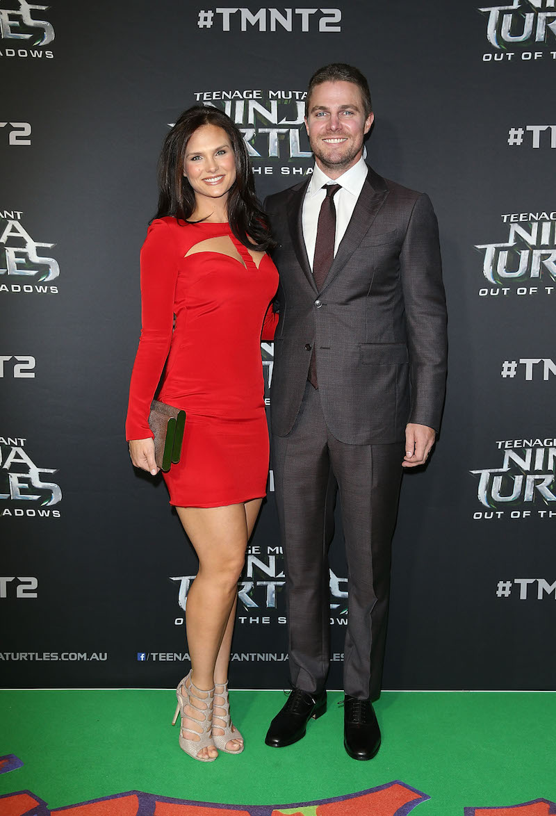 SYDNEY, AUSTRALIA - MAY 29: Cassandra Jean and Stephen Amell arrive ahead of the Australian premiere of Teenage Mutant Ninja Turtles 2 at Event Cinemas George Street on May 29, 2016 in Sydney, Australia. (Photo by Caroline McCredie/Getty Images for Paramount Pictures) *** Local Caption *** Stephen Amell; Cassandra Jean
