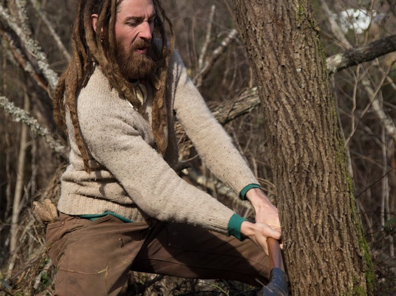 Tony chops down a tree at eh homestead where he lives with wife Amelia