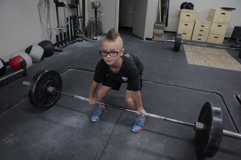Gage about to deadlift a heavy weight.