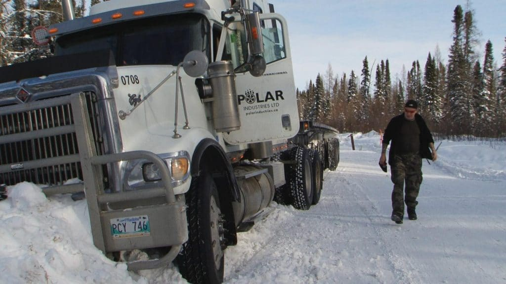 """Art Burke assesses the damage to his rig on the season 10 premiere of HISTORY'S """"Ice Road Truckers"""""""