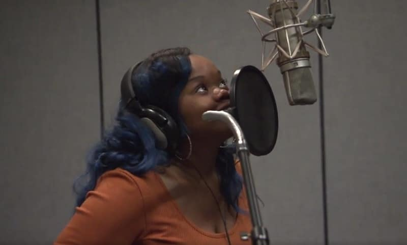 Monie speaks into a microphone during her voiceover audition on tonight's Little Women: Atlanta