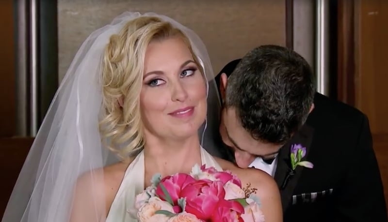 Heather has her neck nibbled by Derek moments after the pair wed on Married At First Sight