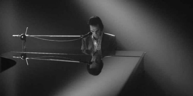 Nick Cave playing piano