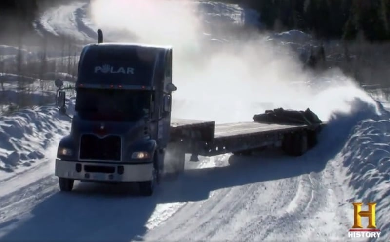 A still of the Polar truck dragging its trailer on Ice Road Truckers
