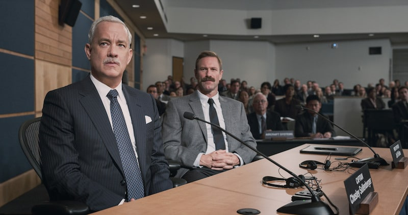 Hanks and Eckhart in the NTSB hearing in Sully
