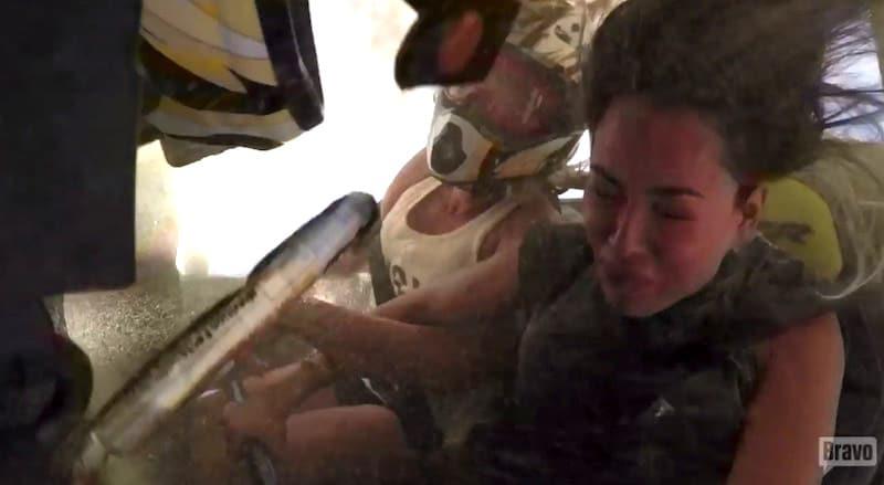 Kelly's helmet flies off during the barrel-roll leaving her head exposed