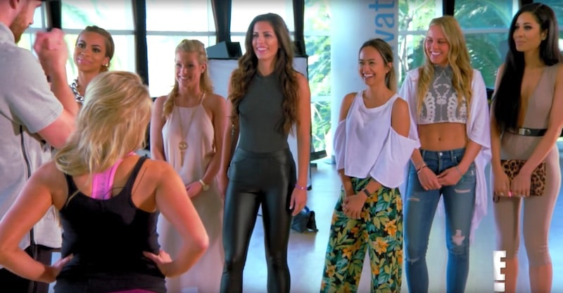 The girls chat with Travis after arriving at the gym for the group date on Catching Kelce