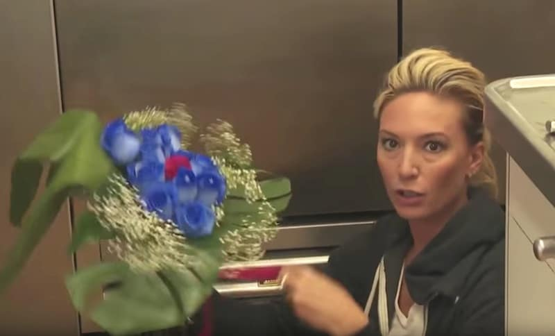 Kate Chastain's plan — to have Ben give Emily a bouquet of blue roses for Valentine's Day