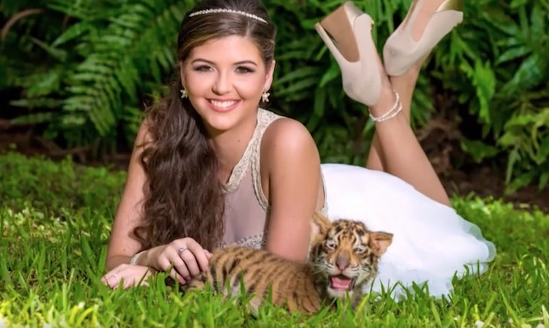 Lizi poses with one of the baby tigers on this week's episode of Sweet 15: Quinceanera