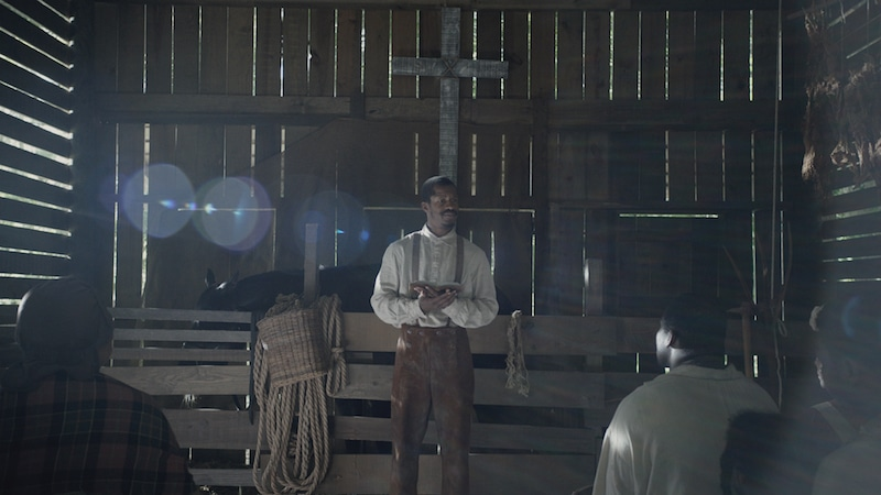 Parker's Nat Turner preaching to fellow slaves in front of a cross