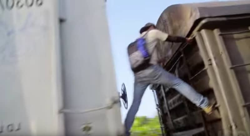 A Mexican straddles carriages on a moving train on a segment from Vice News Tonight this week