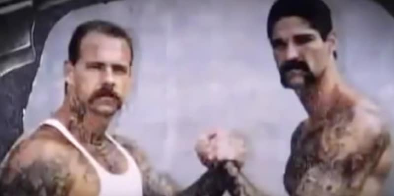 A grainy photo of two members of the Ayran Brotherhood