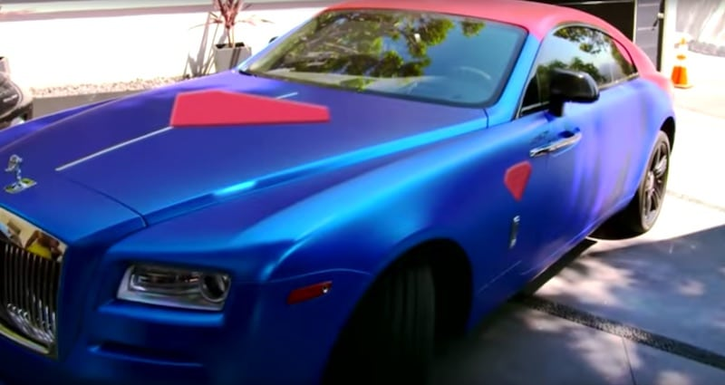"Bastian Yotta's ""Superman"" Rolls-Royce, wrapped in the superhero's trademark blue and red"