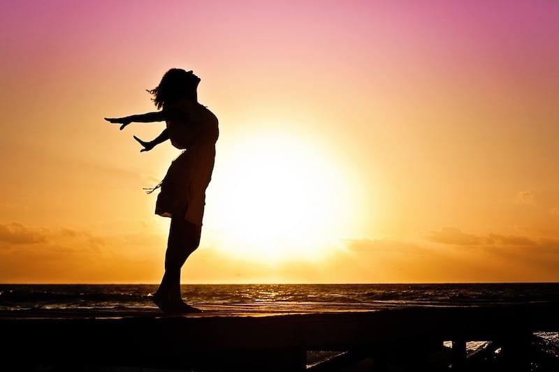 Single woman at sunset