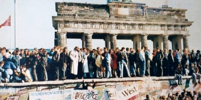 Generation X saw the fall of the Berlin Wall (pictured)