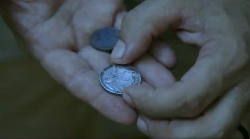 The coin the team find which suggests the Nazis used the building as a compound