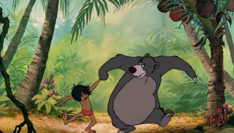 Baloo the bear and Mowgli dance in the original The Jungle Book movie