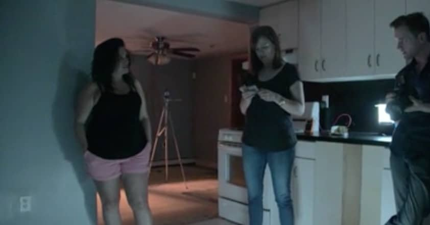 Amy and Adam with the homeowner in the basement that seems haunted
