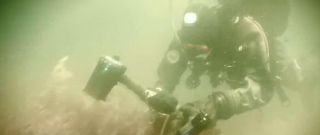 A diver explores the Oak Island swamp