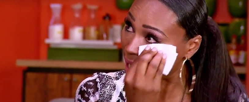 Cynthia hold a tissue to her eye as she cries during chat with Peter